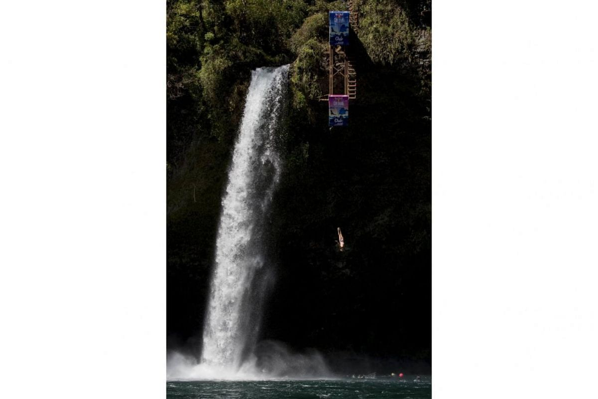 Jonathan Paredes of Mexico takes his dive at the world series of Red Bull Cliff Diving, in Saltos de Rininahue, Chile, on Oct 21, 2017.
