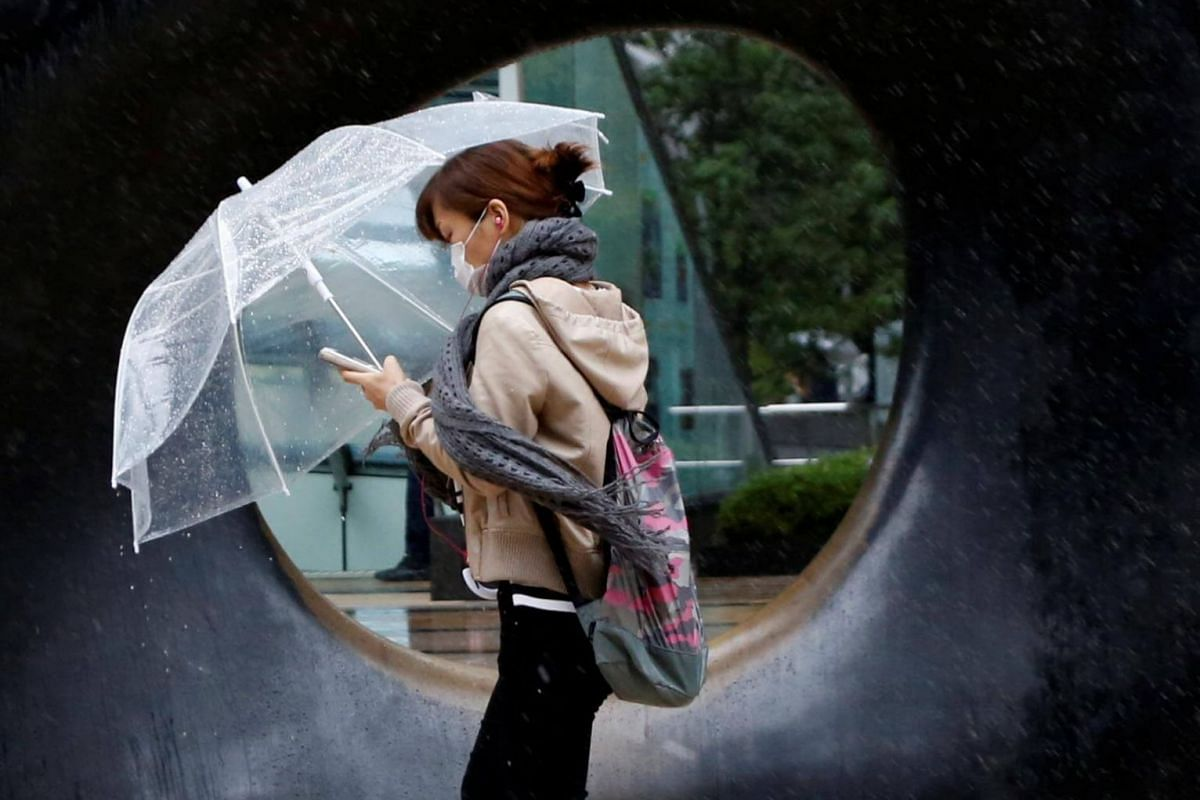 A woman walks in heavy rain and wind as Typhoon Lan approaches Japan's mainland, in Tokyo, Japan, on Oct 22, 2017.