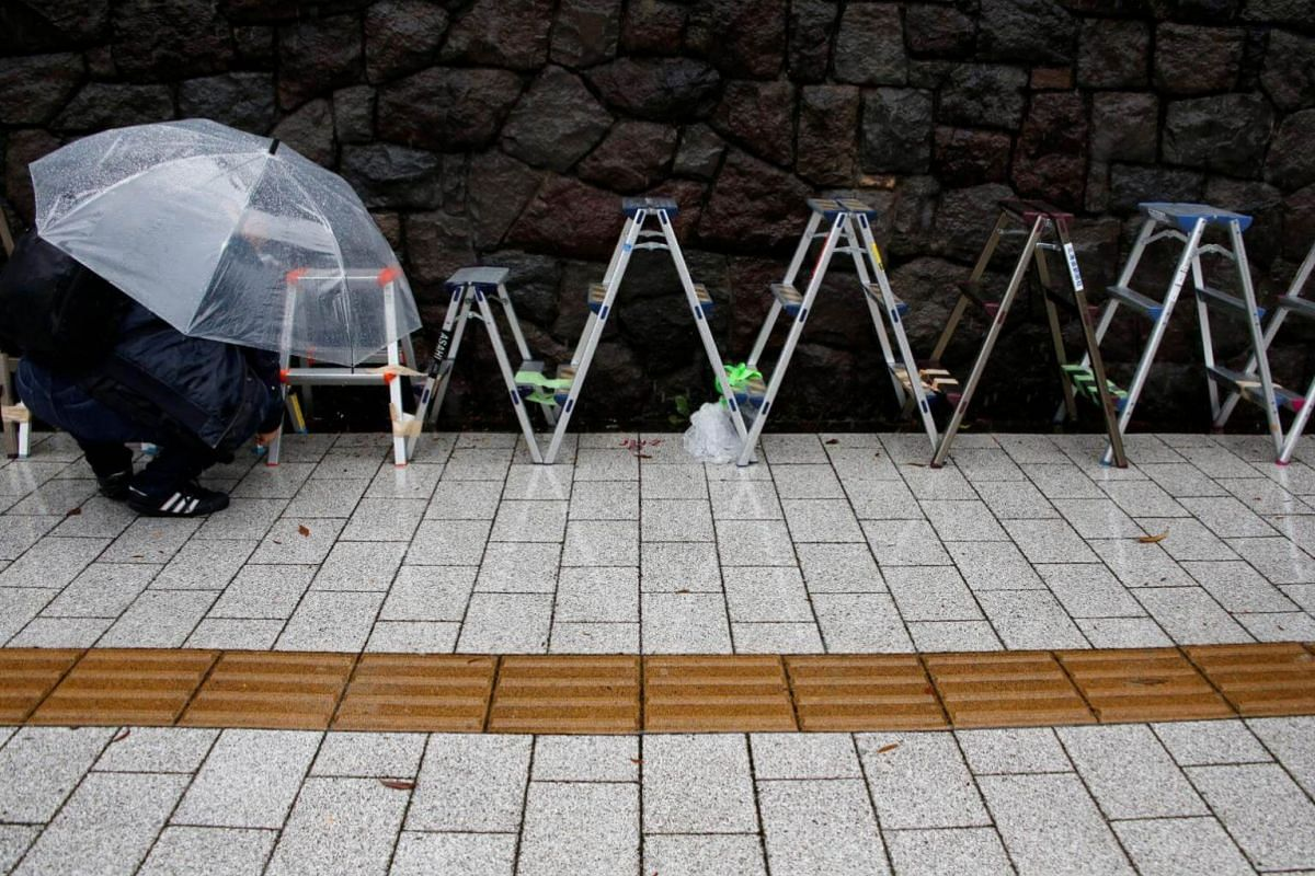 Stepladders used for election coverage by photographers are lined up outside of the ruling Liberal Democratic Party headquarters as Typhoon Lan approaches Japan's mainland in Tokyo, Japan, on Oct 22, 2017.