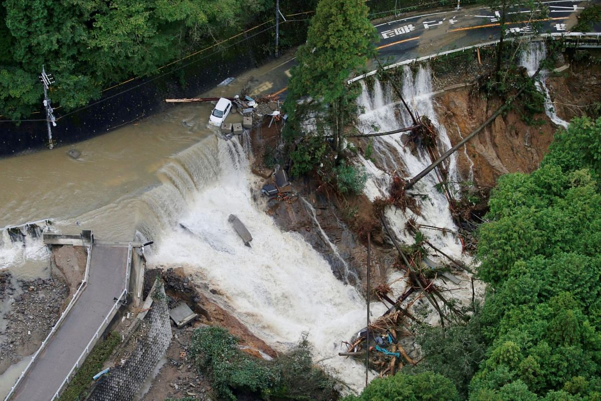 A collapsed road is seen following torrential rain caused by typhoon Lan in Kishiwada, Japan in this photo taken by Kyodo on October 23, 2017. PHOTO: REUTERS/KYODO