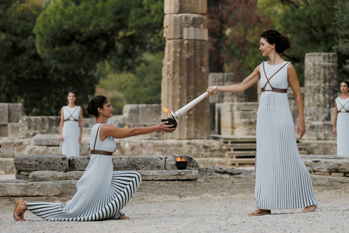 Greek actress Katerina Lehou, playing the role of High Priestess, holds a torch during the dress rehearsal for the Olympic flame lighting ceremony for the Pyeongchang 2018 Winter Olympic Games at the site of ancient Olympia in Greece. PHOTO: REUTERS
