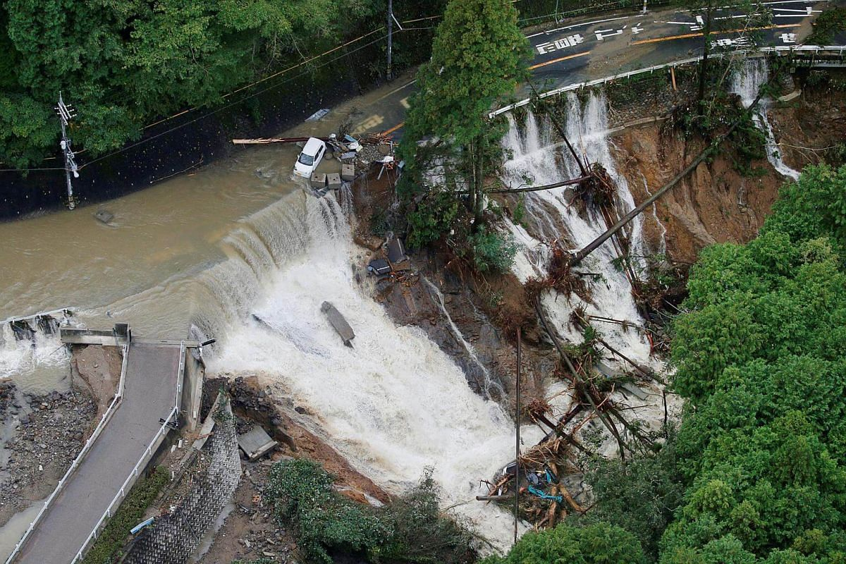 A collapsed road is seen following torrential rain caused by typhoon Lan in Kishiwada, Japan,  on Oct 23, 2017.