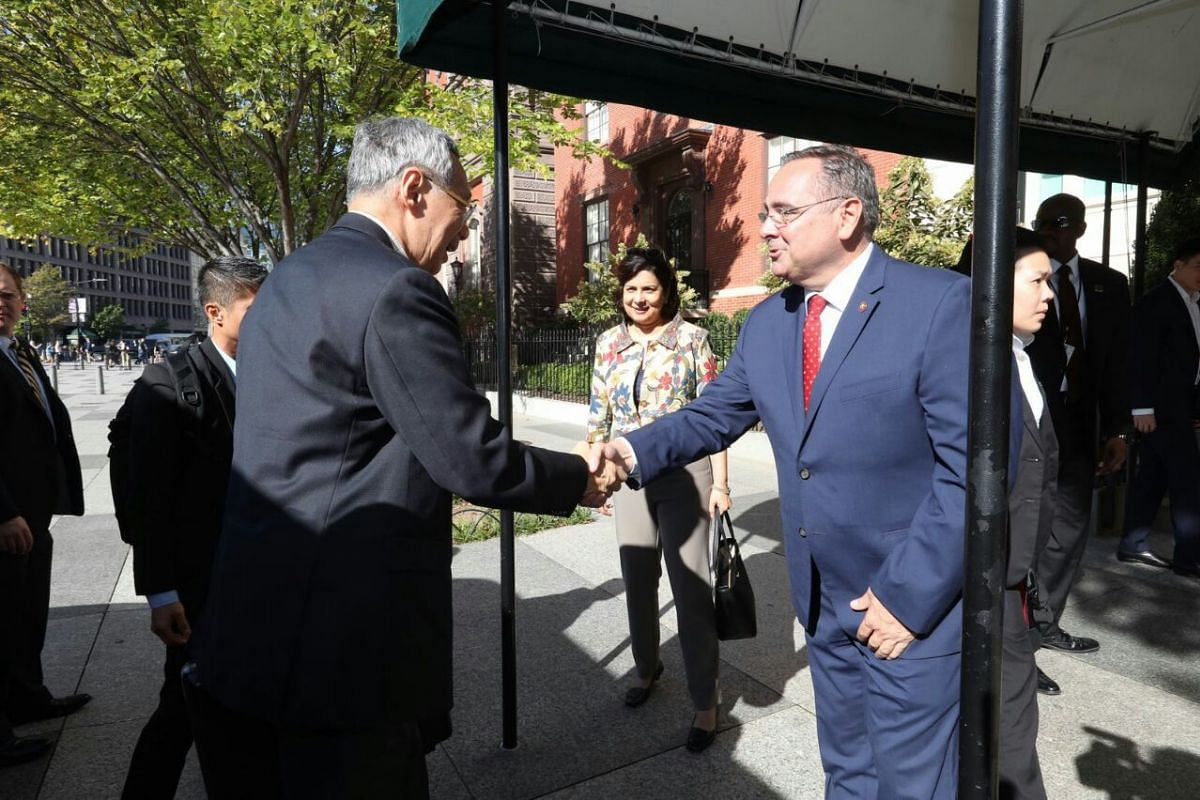 PM Lee is welcomed by Blair House General Manager Matthew Wendel upon his arrival on Saturday (Oct 21).