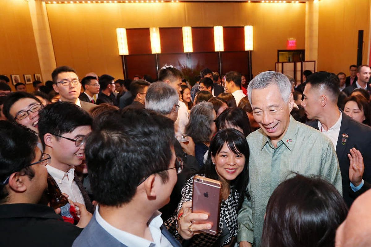 Prime Minister Lee Hsien Loong takes a selfie with Angeline Tan, 46, at a reception with Singaporeans at the Singapore Embassy in Washington.
