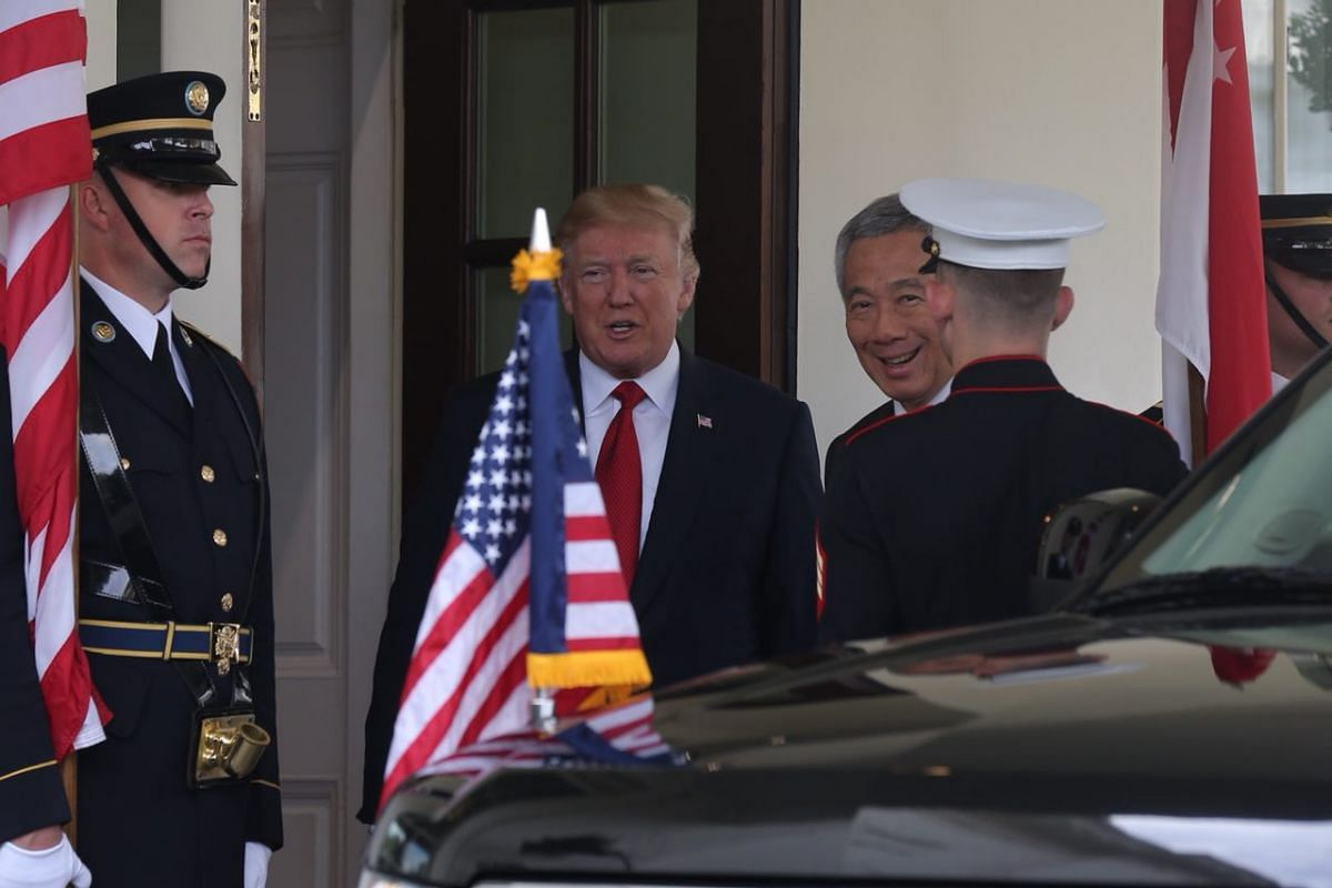 PM Lee and US President Trump arrive for their meeting at the White House on Monday (Oct 23).