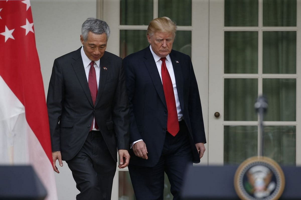 PM Lee and President Trump arrive at the White House Rose Garden to deliver their joint statement.