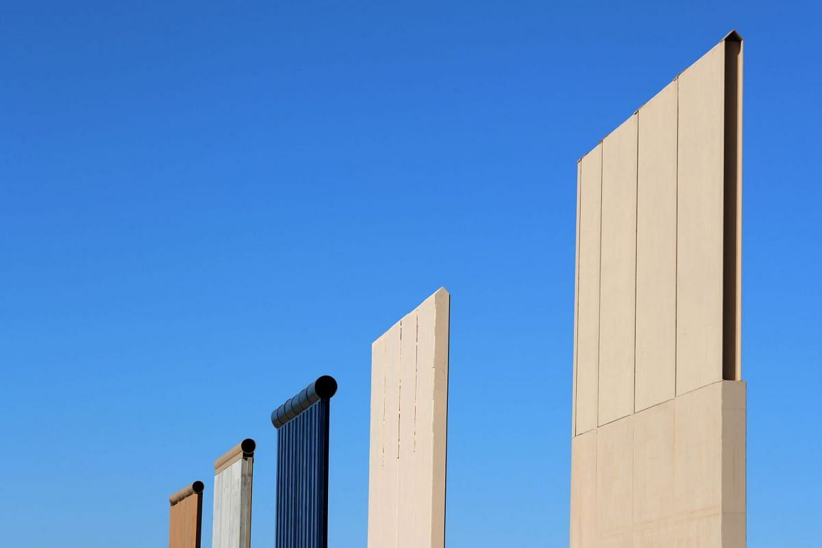 The top of five of U.S. President Donald Trump's eight border wall prototypes are shown near completion along U.S.- Mexico border near San Diego, California, U.S., October 23, 2017.
