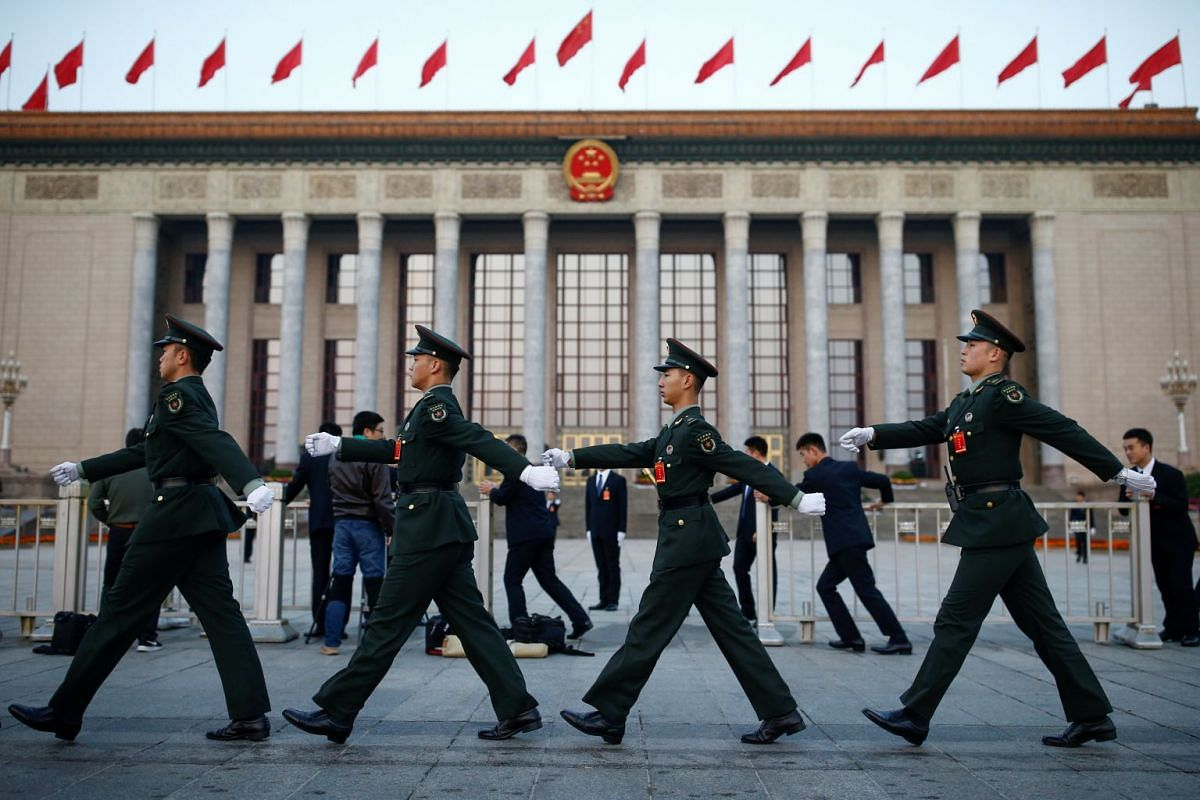 Paramilitary police march past the Great Hall of the People before the start of the closing session of the 19th National Congress of the Communist Party of China, October 24, 2017.