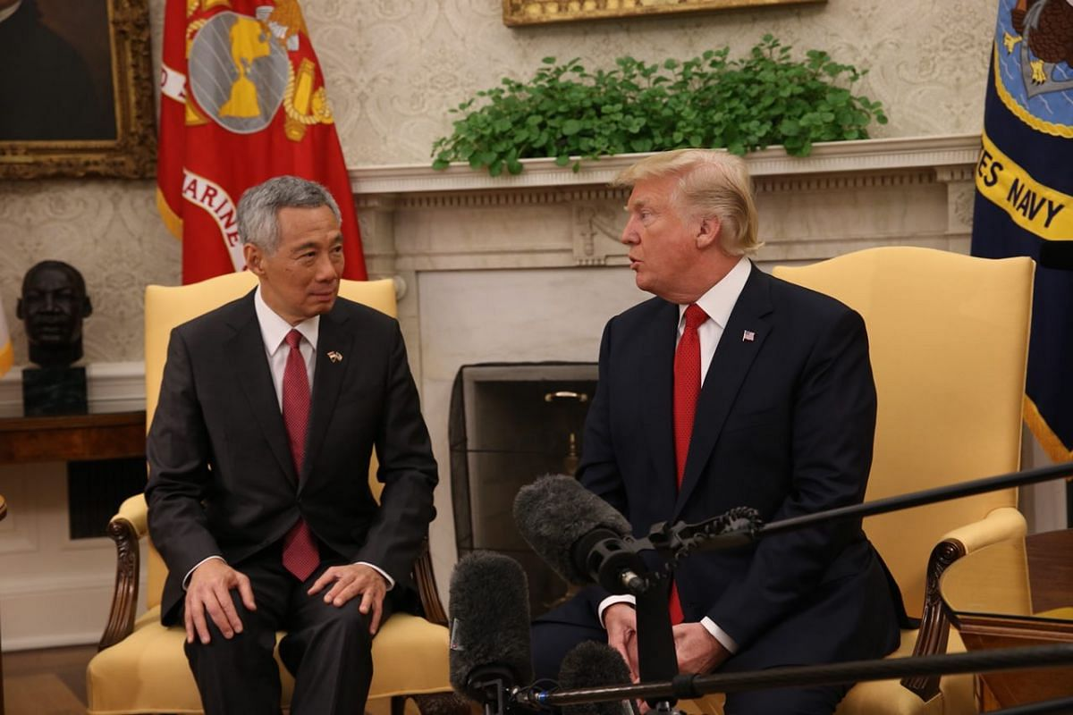 PM Lee and President Trump speak to the press ahead of their bilateral talks at the White House on Monday (Oct 23).