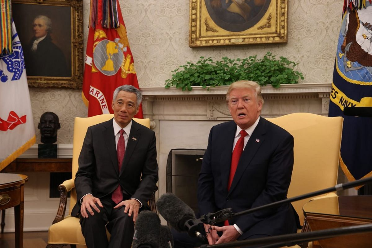 PM Lee and President Trump speak to the press before holding bilateral talks at the White House on Monday (Oct 23).
