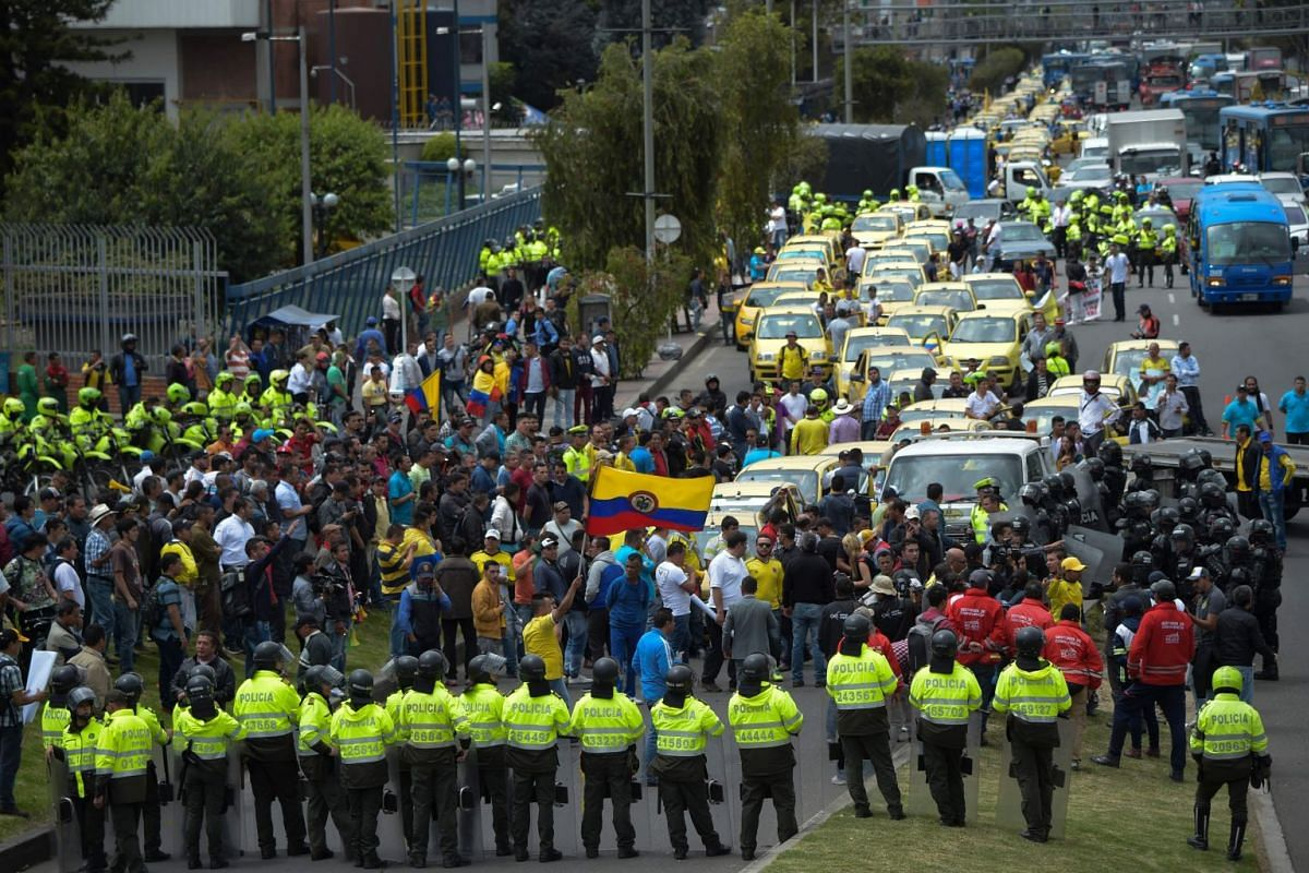 Taxi drivers stage a protest against the private hire company Uber in Bogota, on Ocotober 23, 2017.