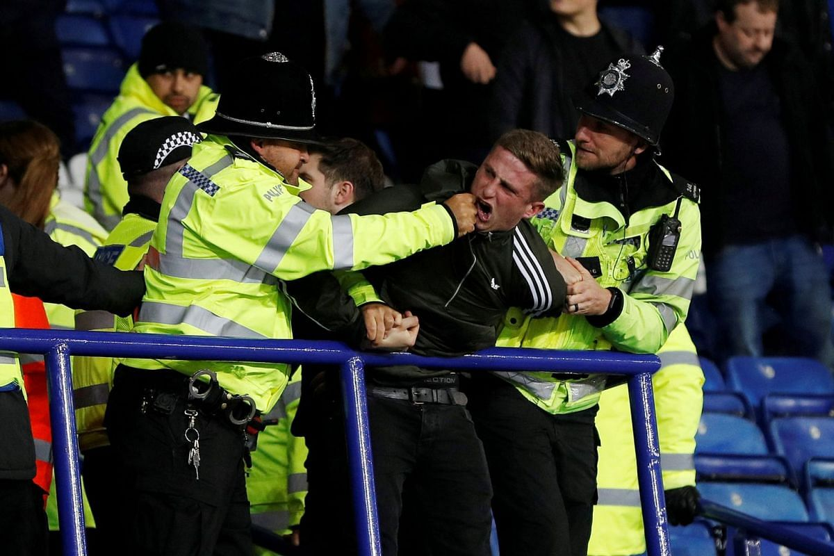 Police apprehend a Leeds United fan after the soccer match between Leicester City and Leeds United at King Power Stadium in Leicester, Britain on Oct 24, 2017.