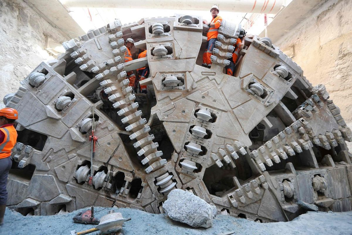 Workers tend to the tunnel boring machine which has finished digging the future west-east line of the tramway in Nice, south-eastern France, on Oct 24, 2017.