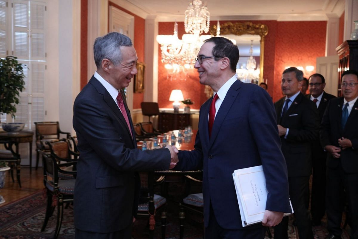 PM Lee Hsien Loong shakes hands with United States Secretary of the Treasury Steven Mnuchin.