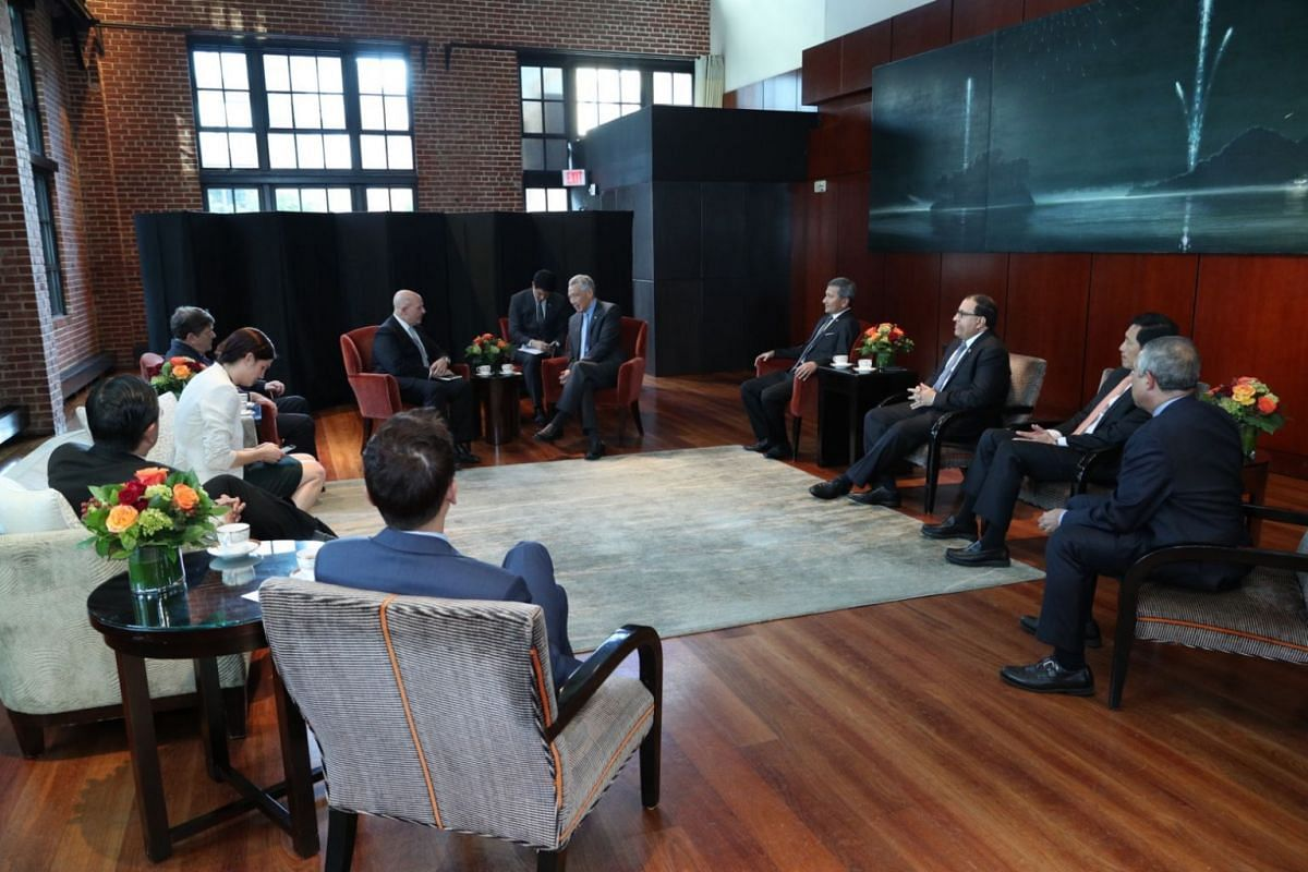 PM Lee Hsien Loong speaks to United States National Security Adviser H.R. McMaster while other ministers look on.