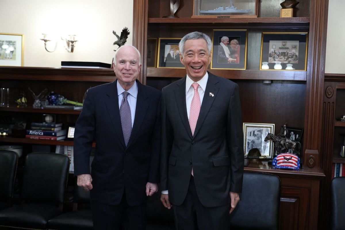 PM Lee Hsien Loong poses for a picture with Senator John McCain.