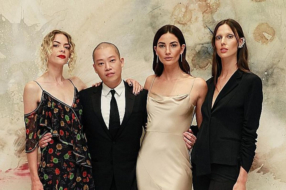 Jason Wu is pictured at the launch of his Jason Wu Fragrance early last month in New York, with actress (from left) Jaime King and models Lily and Ruby Aldridge.