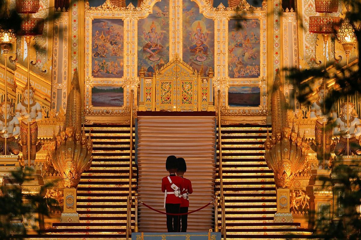 Royal guards stand at the crematorium tower before the funeral procession for Thailand's late King Bhumibol Adulyadej in Bangkok.