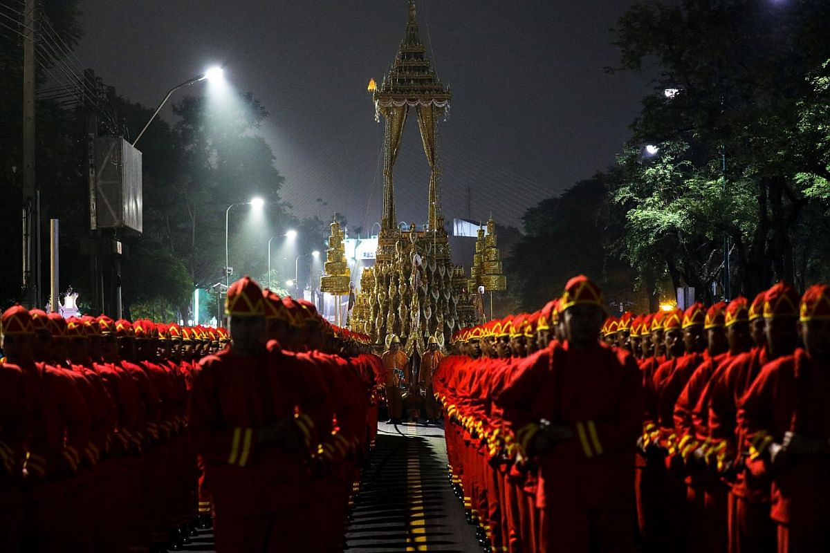 The Great Victory Royal Chariot is pulled by Thai army officials dressed in ancient uniforms in preparation for the Royal Cremation ceremony of Thailand's late King Bhumibol Adulyadej near the Grand Palace in Bangkok.