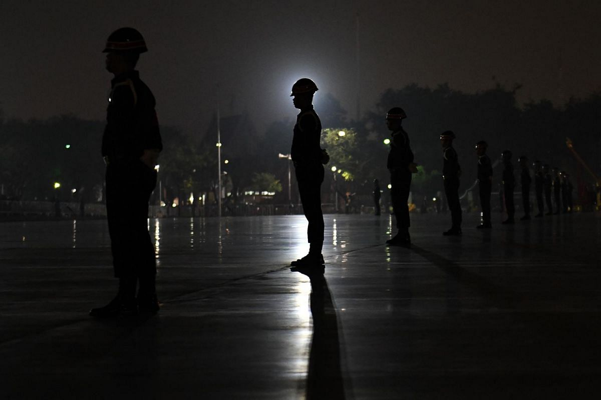 Soldiers stand guard before the funeral procession for the late Thai King Bhumibol Adulyadej in Bangkok.