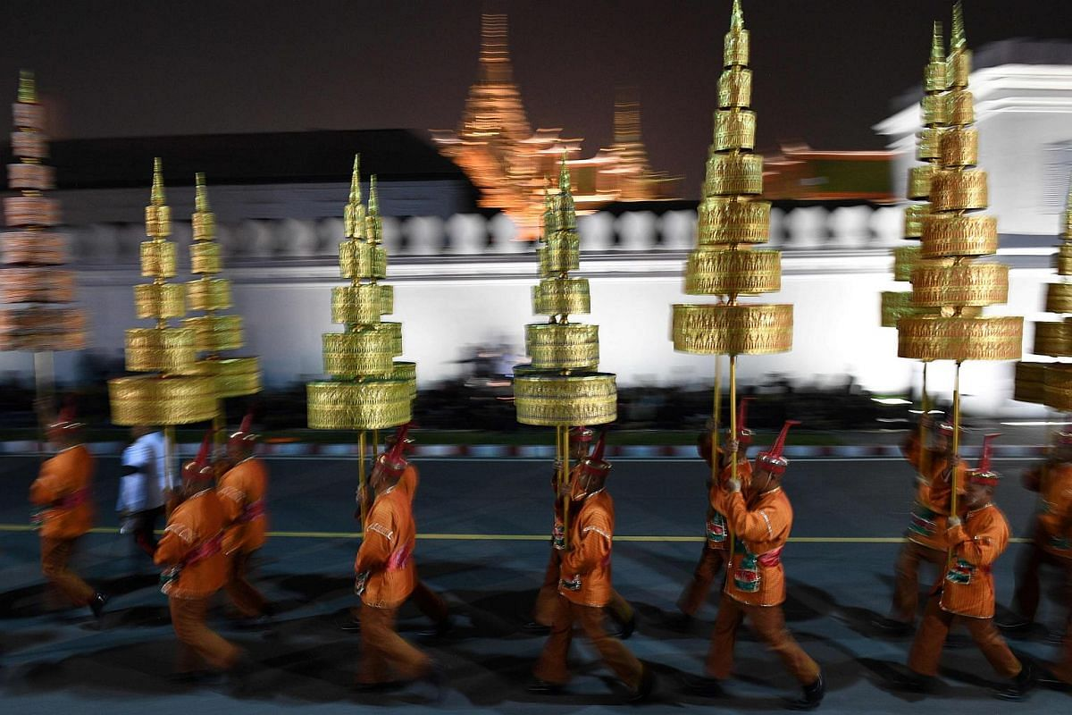 Performers walk from the Grand Palace as they prepare to take part in the funeral procession for the late Thai King Bhumibol Adulyadej in Bangkok.