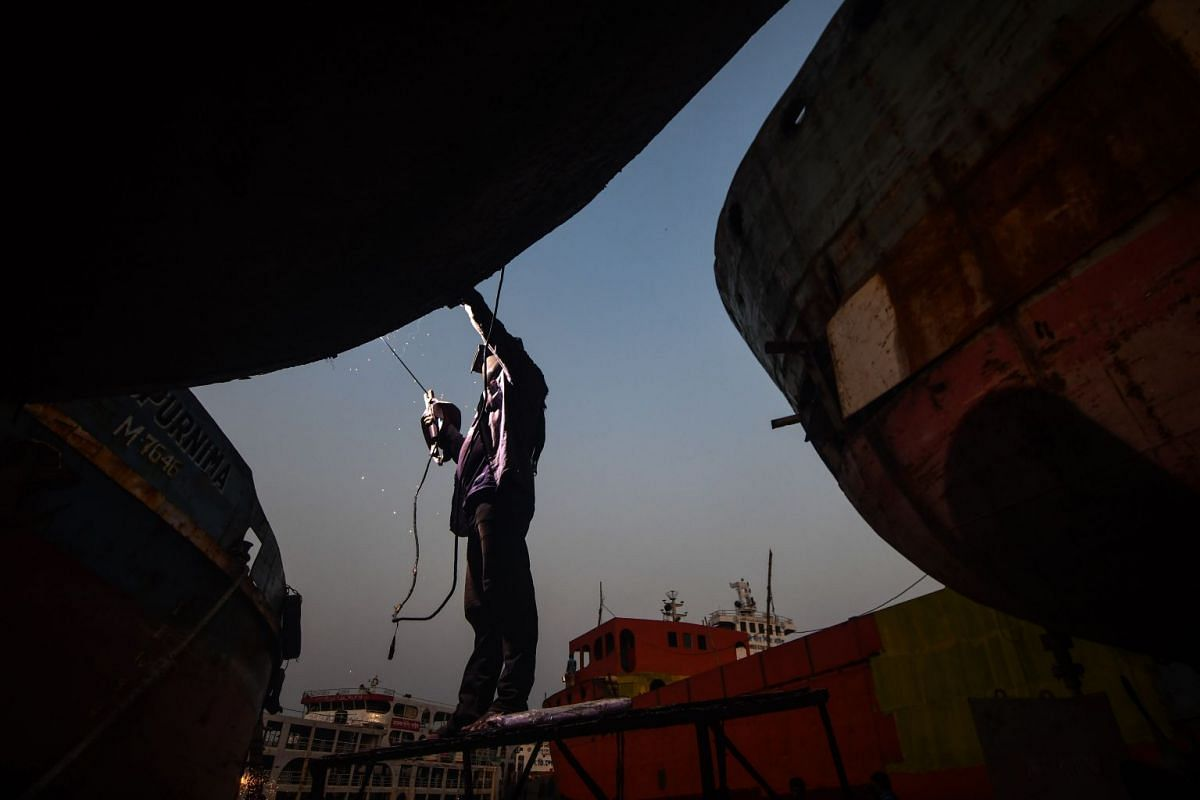 A Bangladeshi welder works on a ship in a dockyard beside the Buriganga River in Dhaka on October 26, 2017. PHOTO: AFP