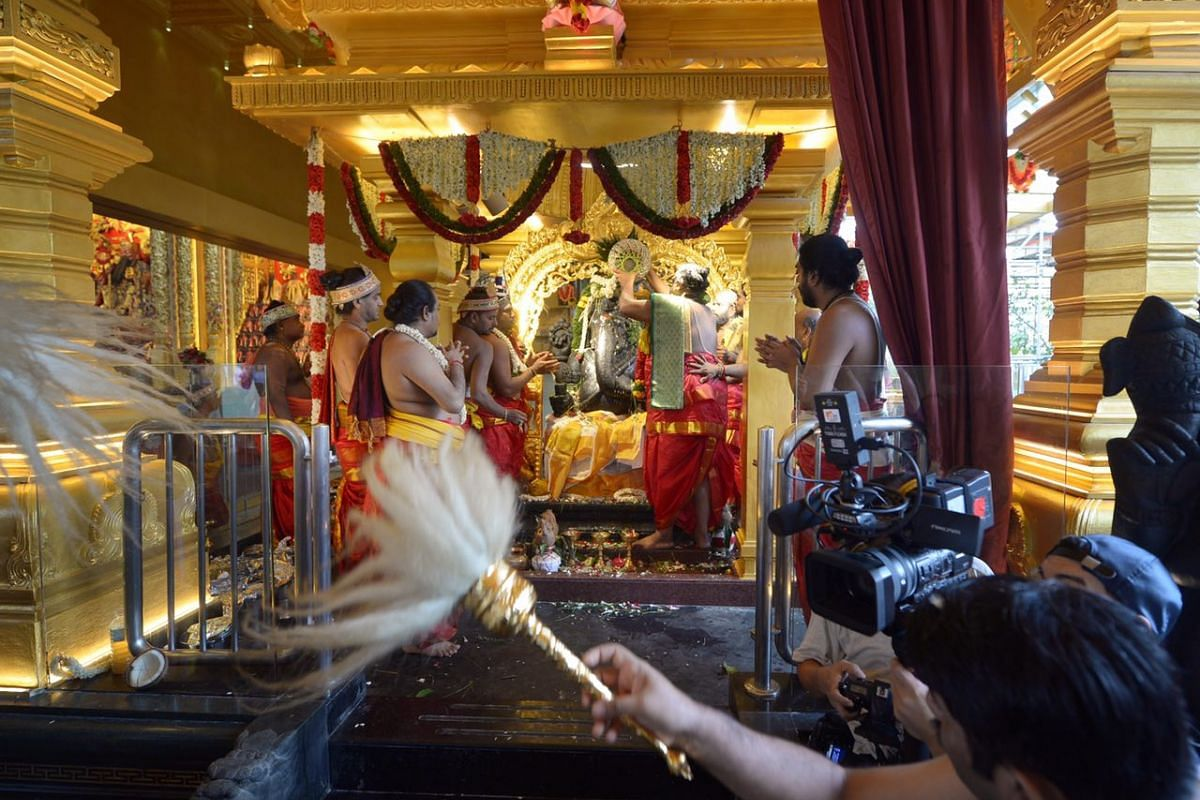 The shrine being blessed. The consecration ceremony is done once every 12 years to restore the power of the idol deity.
