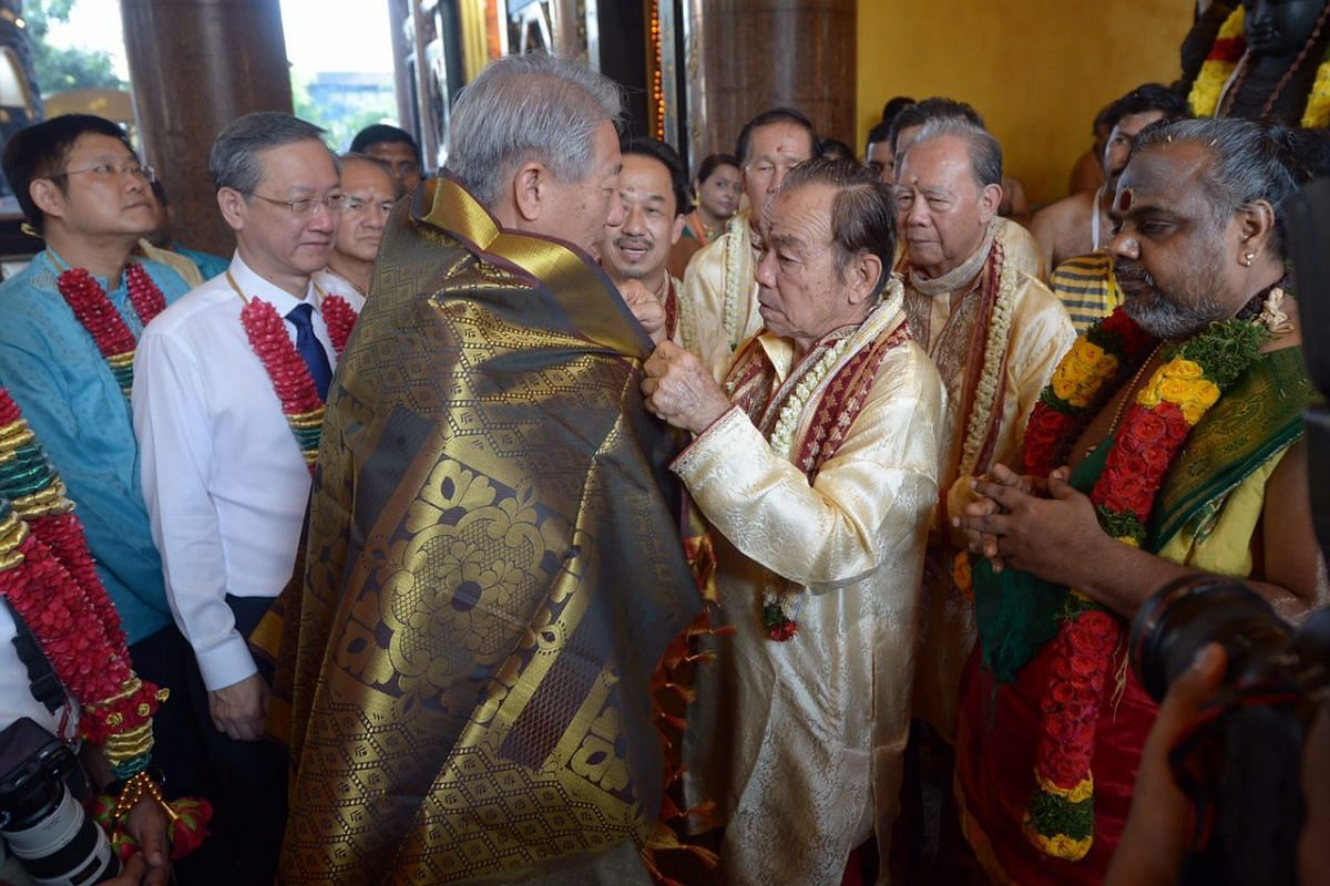 DPM Teo Chee Hean is robed with a garment at the ceremony.