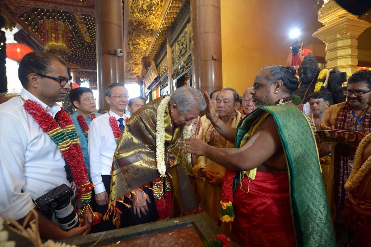DPM Teo Chee Hean is garlanded at the consecration ceremony.