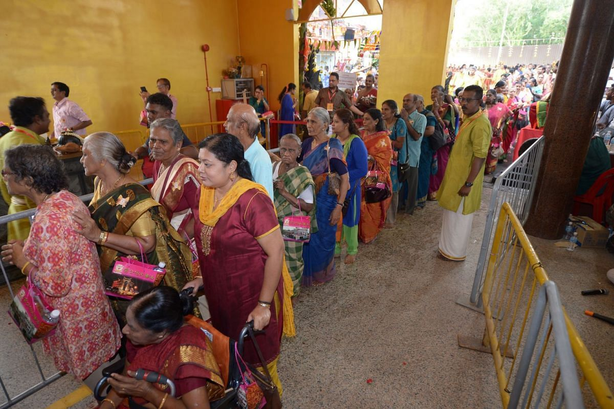 Devotees lining up to pray before the shrine at the consecration ceremony.