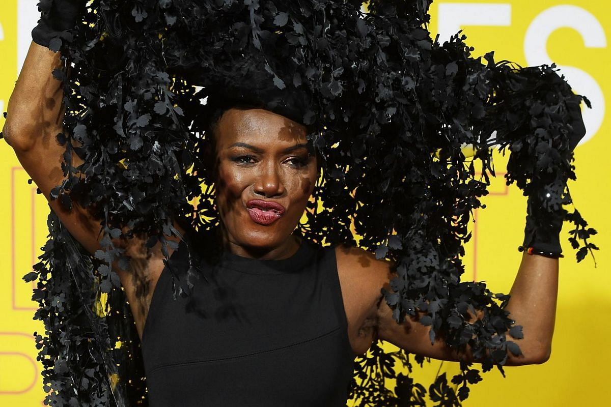 Jamaican singer Grace Jones arrives at the premiere in a dramatic Philip Treacy headpiece.