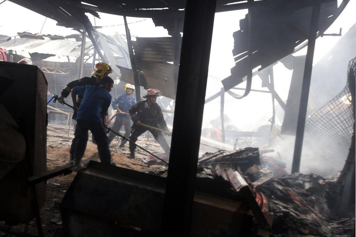 Indonesian rescue team searching for victims after the explosion at a fireworks factory at Kosambi village in Tangerang, Indonesia Banten province.