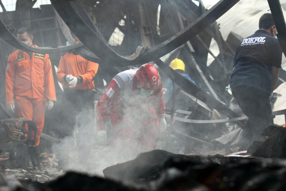Indonesian rescue team search for victims after the explosion.
