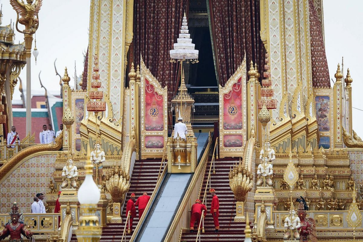 The royal urn of the Late Thai King Bhumibol Adulyadej is transported on a ramp into the cremation chamber.