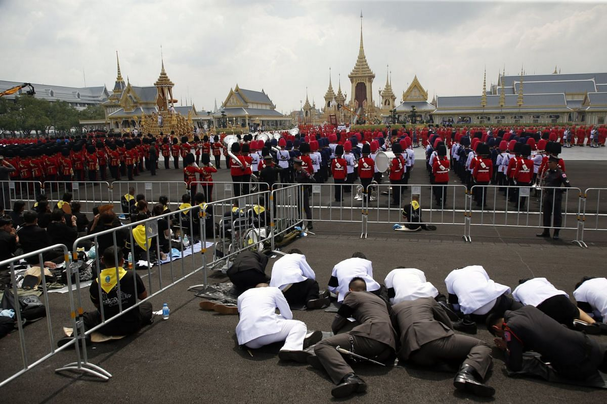 People gathering during the royal cremation ceremony outside the Royal Crematorium at Sanam Luang in Bangkok, Thailand.