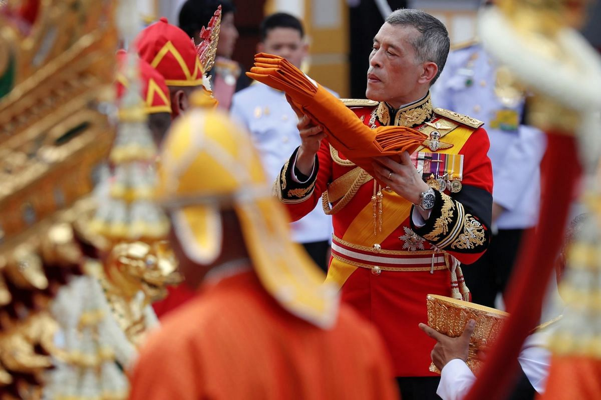 Thai King Maha Vajiralongkorn, dressed in a ceremonial military uniform, taking part in the cremation ceremony, which was attended by dignitaries and royalty from all over the world.