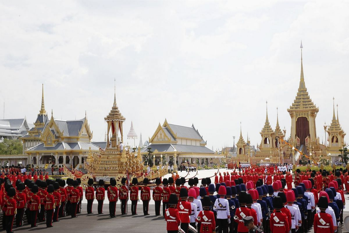A two-century-old chariot bearing the royal urn arriving at the crematorium in Bangkok yesterday. Since King Bhumibol Adulyadej died last year, more than 12 million people have visited the Grand Palace to pay their respects.
