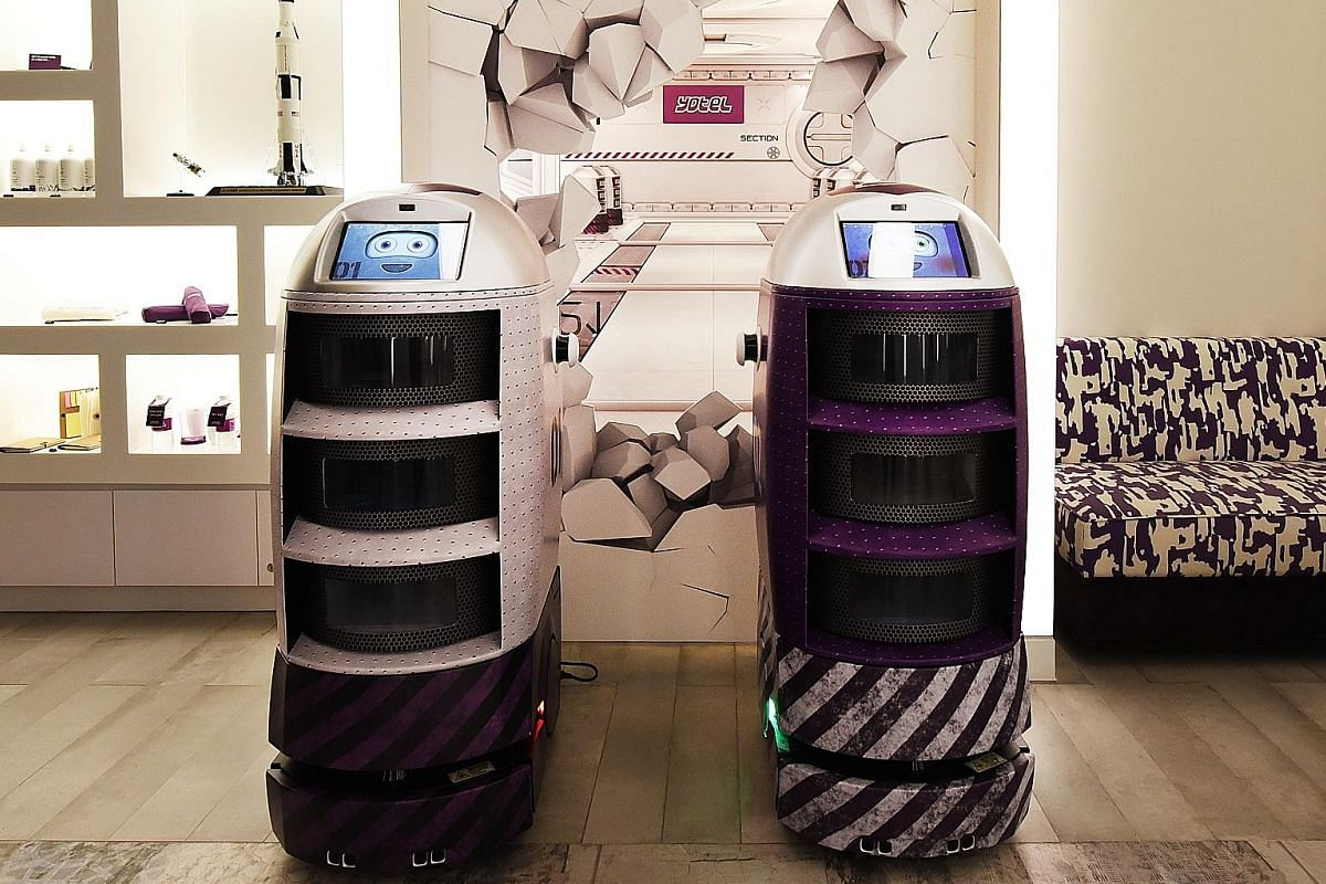 Yotel Singapore uses housekeeping robots to make deliveries. The hotel's restaurant, Grains & Hops (above), and a Premium Queen room with a bunk (below).