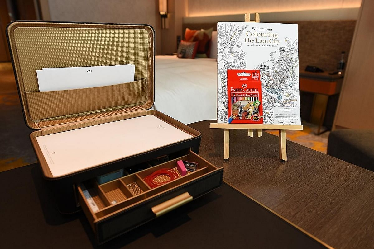 (Right) Each guestroom has a colouring set, including a Colouring The Lion City: A Sophisticated Activity Book For Adults, with whimsical illustrations of Singapore. (Right and far right) Small wood barrels containing barrel-aged cocktails are stacke