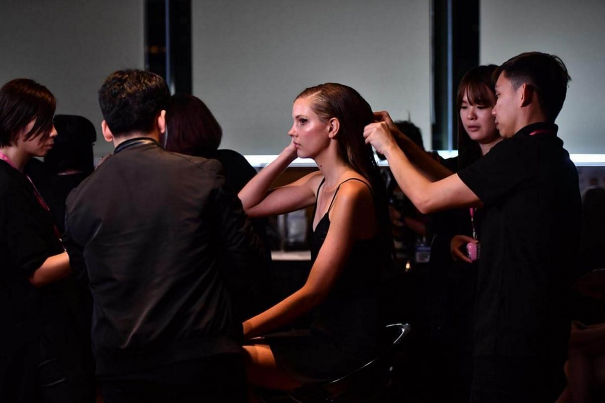 A model gets ready for the Presentation of the Spring 2018 Collection by Jason Wu, at National Gallery Singapore on Oct 28, 2017.