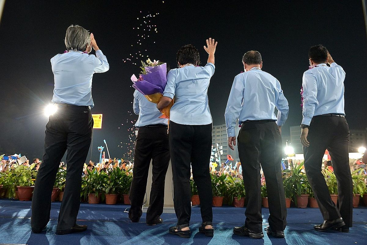 Workers' Party supporters at Hougang Stadium on May 7, 2011. They would learn later that the WP team led by Mr Low Thia Khiang and Ms Sylvia Lim had captured Aljunied GRC in the general election - a breakthrough for the opposition. Mr J. B. Jeyaratna