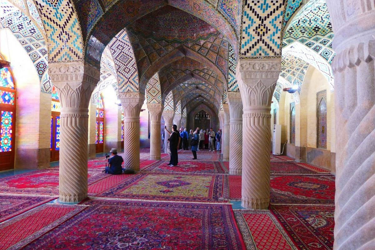 The Pink Mosque in Shiraz, with prayer carpets arranged wall to wall.