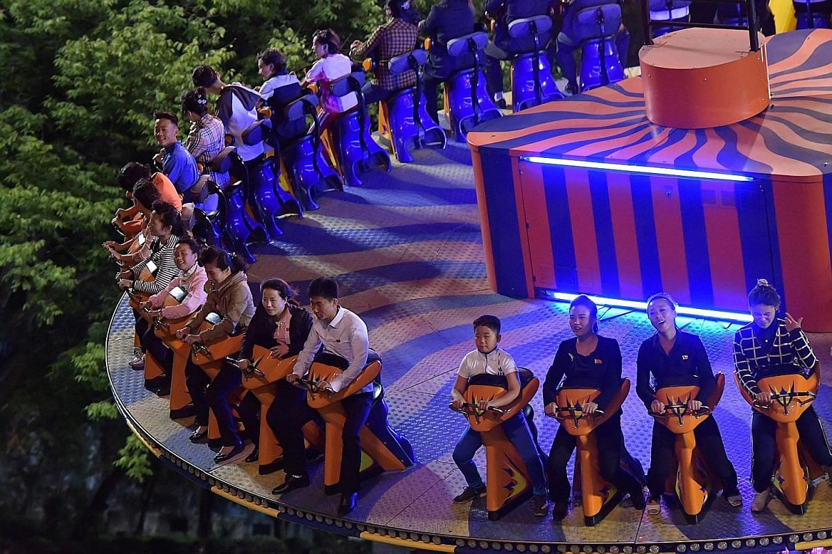 Thrill seekers at Kaeson Youth Amusement Park, where Mr Kim Jong Un is said to have tested all the rides. The park is one of the few avenues for Pyongyang's residents to get a dose of fun. Children performing for visitors at Kyongsang Kindergarten. M