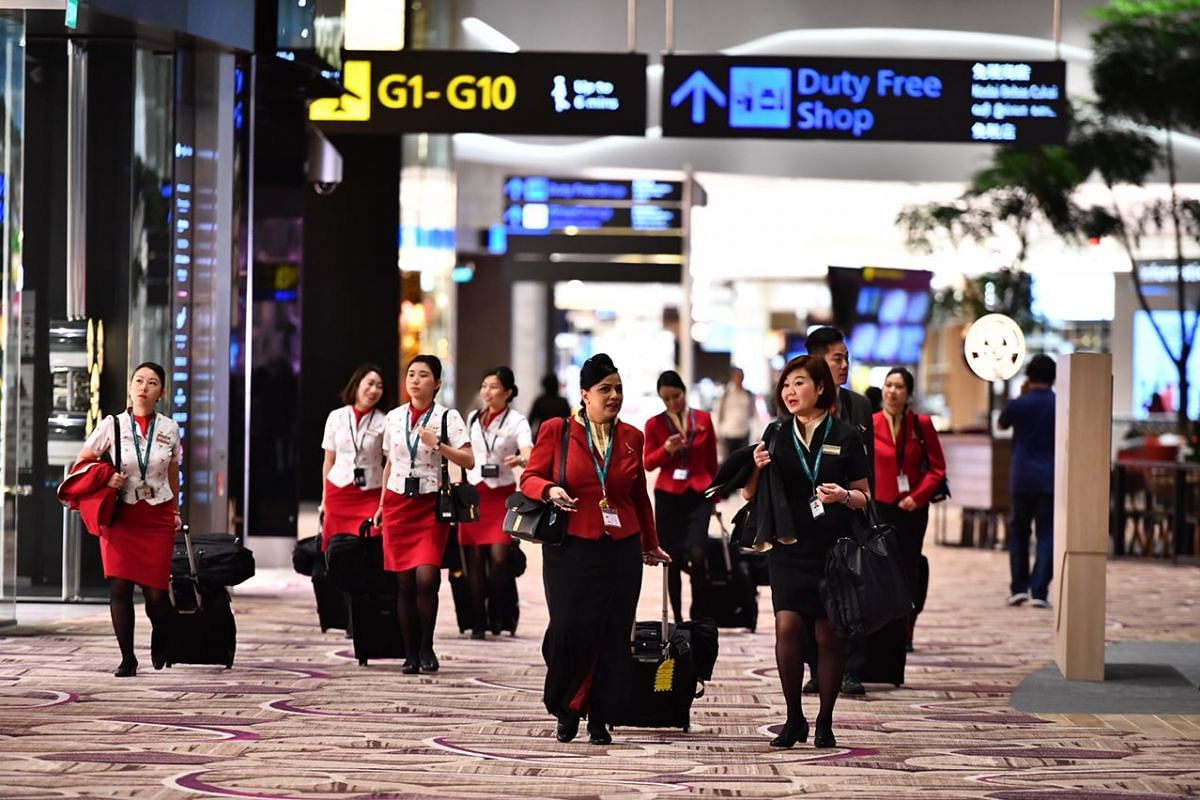 Cathay cabin crew inside the departure transit area.