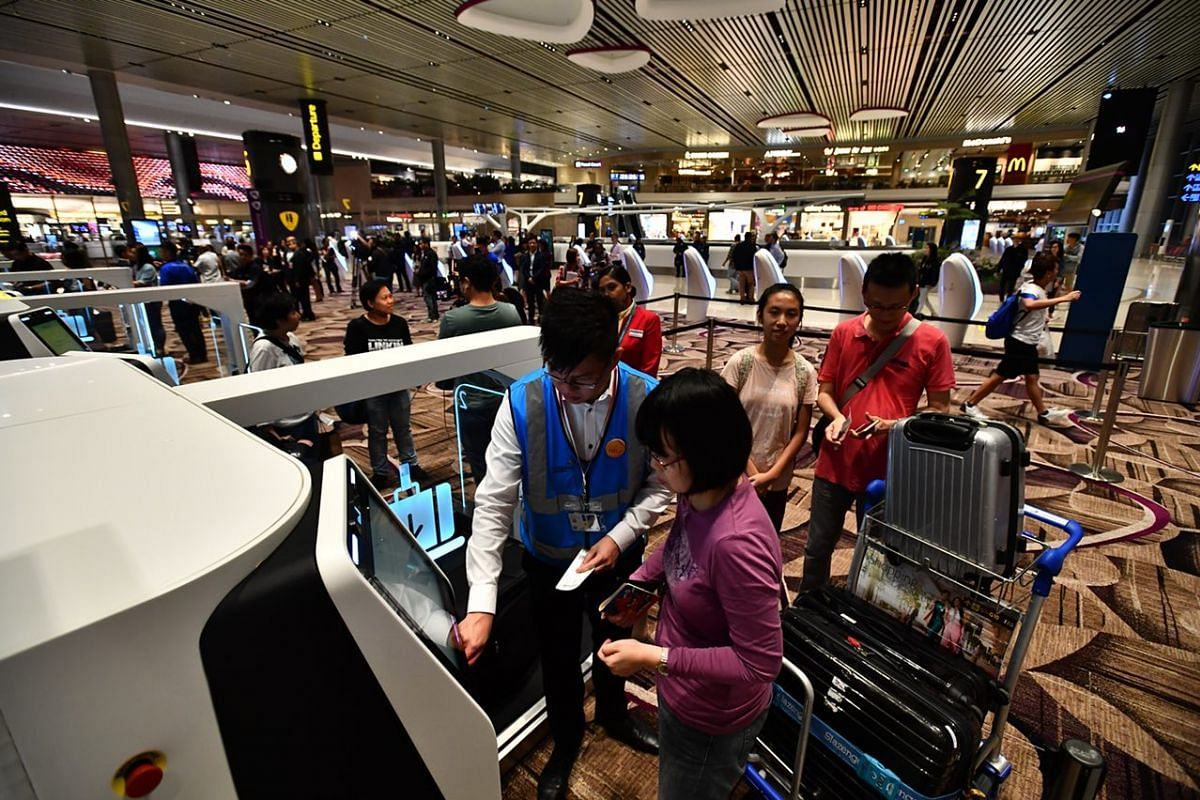 Passengers from first flight Cathay CX650 checking in.