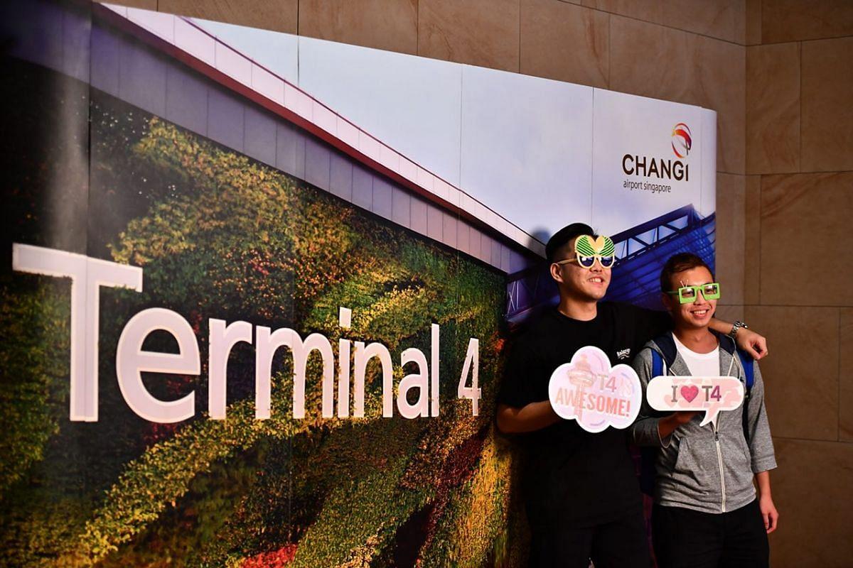 Oscar Ho, (left) 29, and Mingo Ng, 27, at the photo booth before departing to Hong Kong.