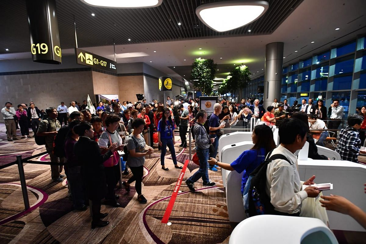 Passengers from first flight Cathay CX650 waiting at the boarding gate.