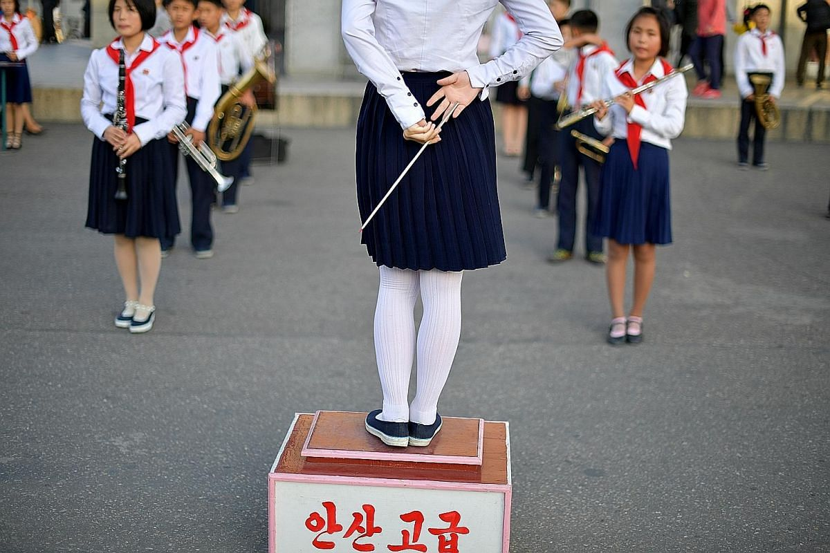 The Monument to Party Founding in Pyongyang is dedicated to the setting up of the Workers' Party of Korea. It is rich in symbolism, with the hammer representing workers, the sickle symbolising farmers and the calligraphy brush denoting intellectuals.