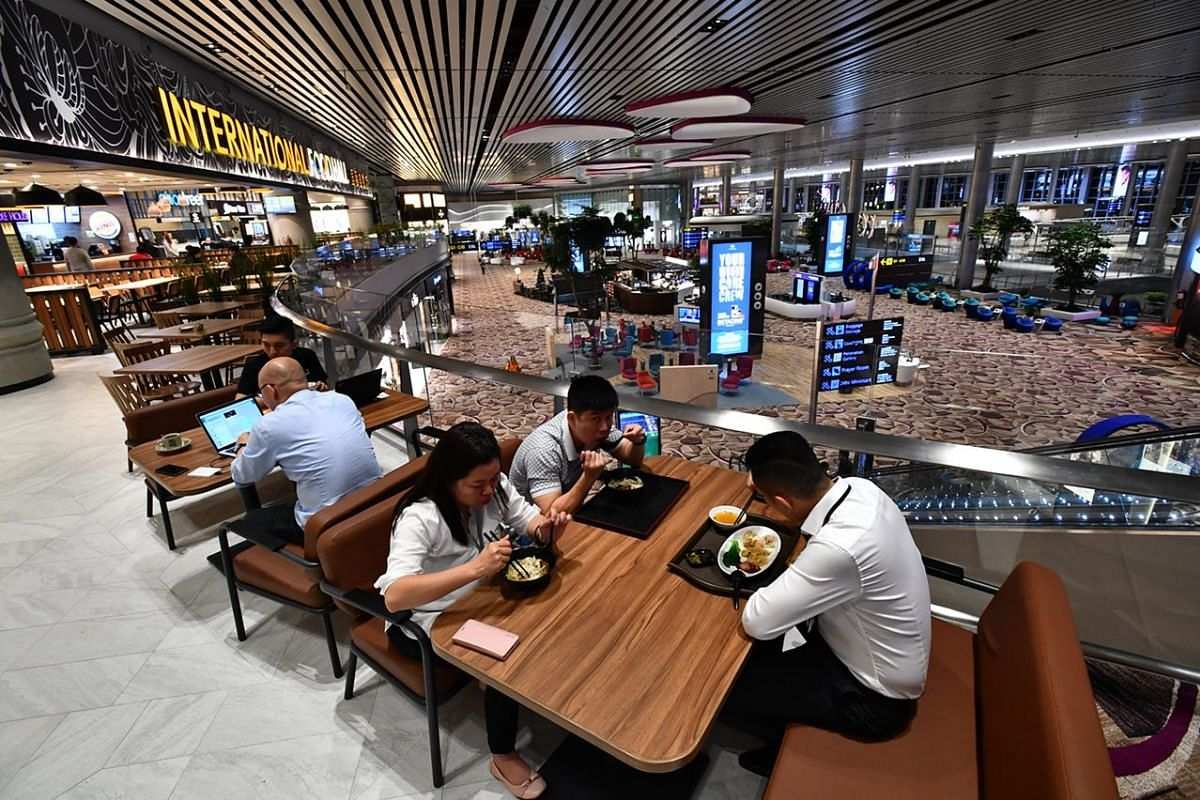 Staff eating at the International Food Hall inside the departure transit area.