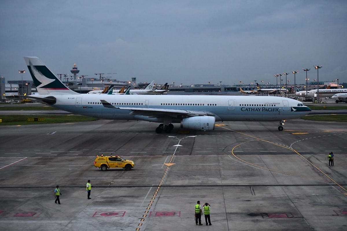 Cathay CX650, the first flight at Changi Airport's Terminal 4, preparing for departure.